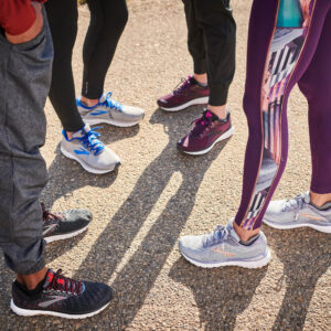 group of runners in kansas city comparing running shoes