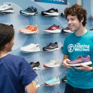 employee helping nurse find properly fitting running shoes in kansas city