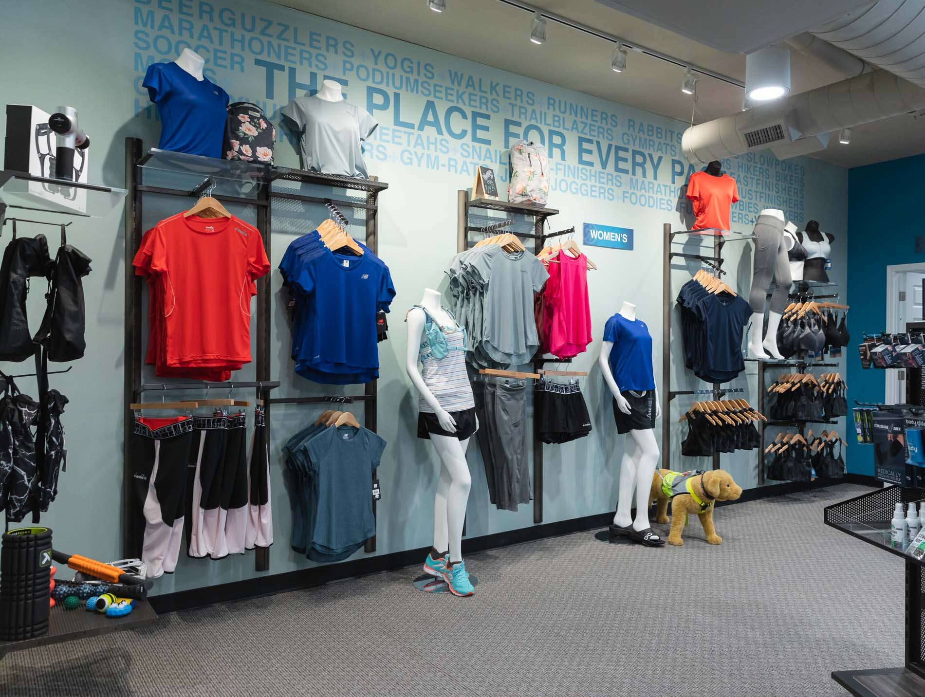 interior photo of the running well store in kansas city featuring men's and women's workout clothes