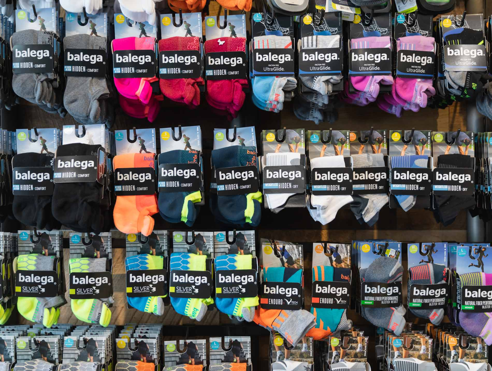selection of running socks available in kansas city at the running well store