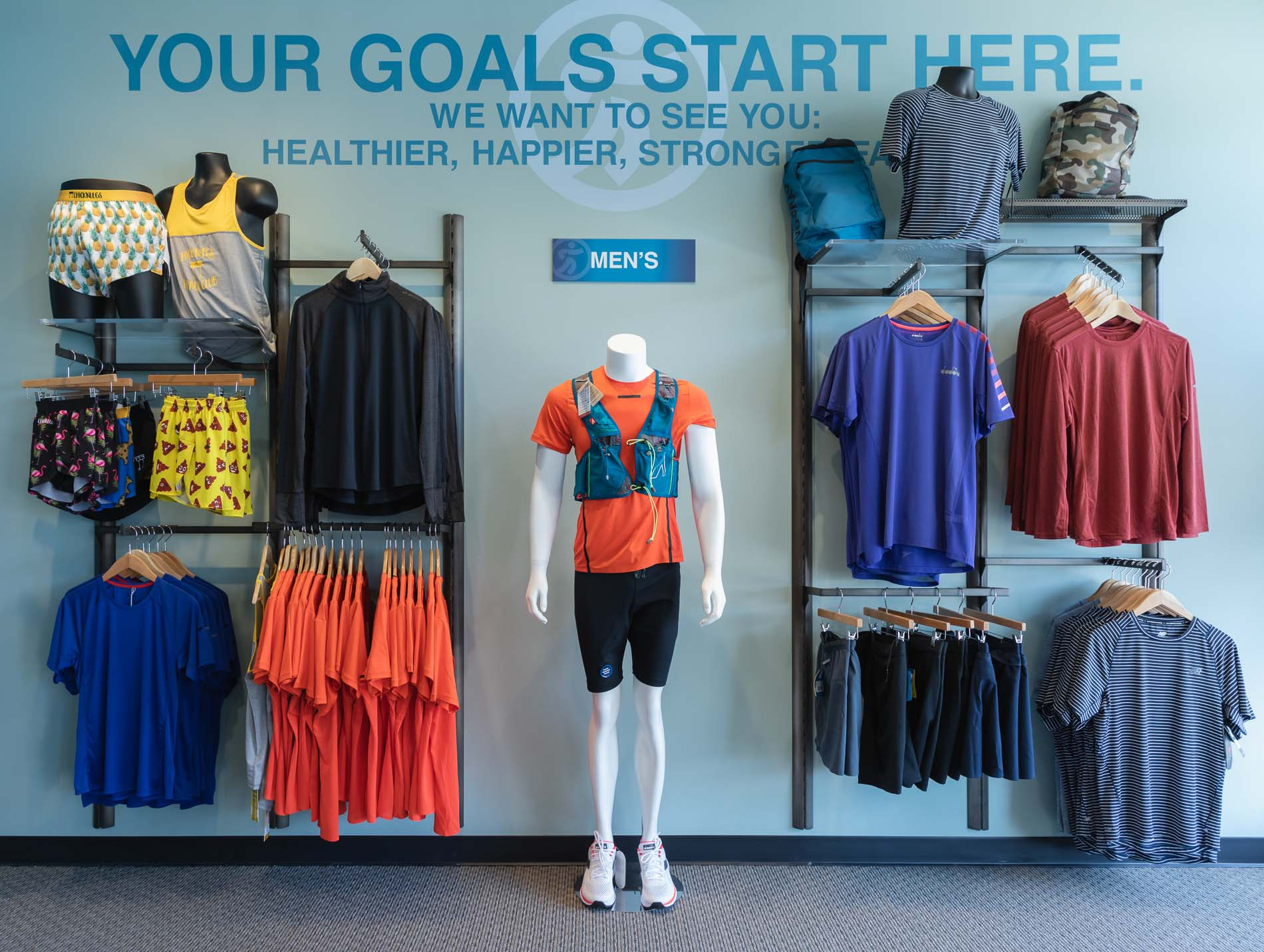image of running and other workout apparel for men available at the running well store in kansas city