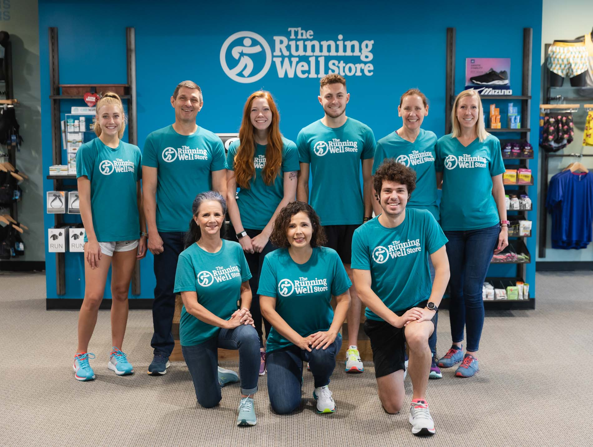 group photo of the running well store team of gurus (associates)