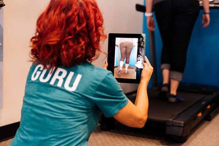 woman performing a stride analysis at the running well store in kansas city