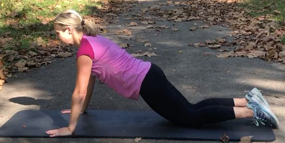 demonstration of a modified push up from a fitness expert at the running well store