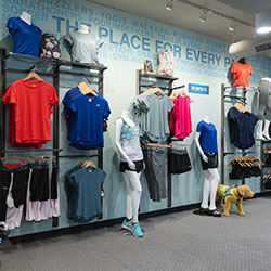 The clothing wall at The Running Well Store in Mission Kansas