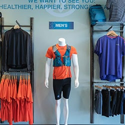 The men's clothing wall at the Mission Running Well Store
