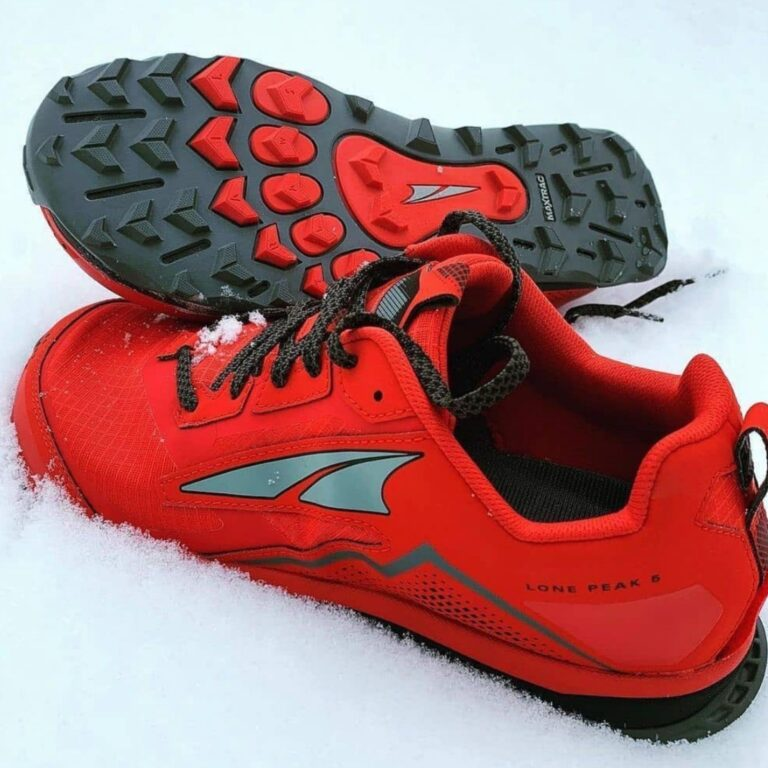 The Altra Lone Peak 5 positioned in snow