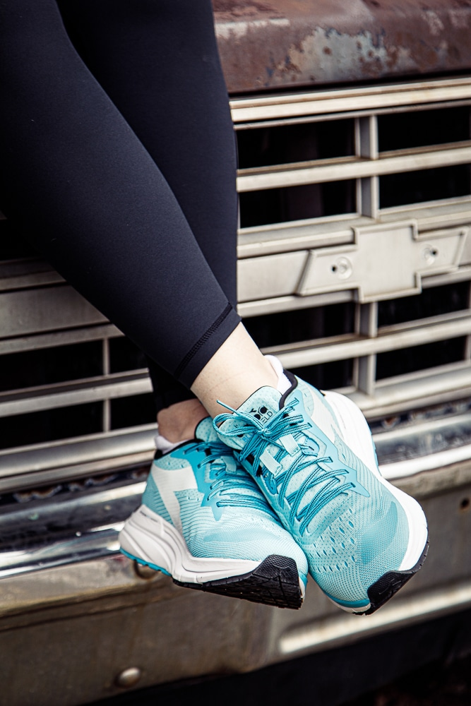 Women showing off her Mythos 6 running and walking shoes